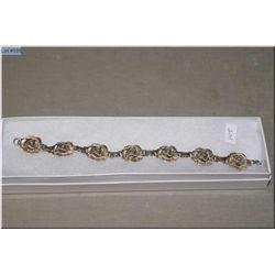 A heavy sterling silver floral rose design bracelet