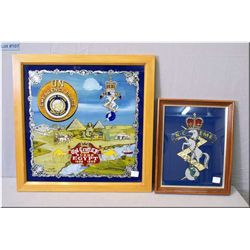Two framed reverse painted crests depicting horses ? United Nations