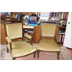 Pair of antique his and hers Canadiana parlour chairs with carved decoration