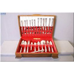 A wooden canteen containing settings for eight of silver plate flatware including dinner knives, din