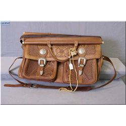 An American West hand tooled leather satchel