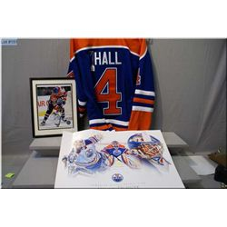 A Taylor Hall signed Oiler's hockey jersey and a framed autographed Sam Gagner hockey photograph and