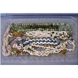A selection of vintage jewellery including beaded and shell necklaces, rings, pendants etc.