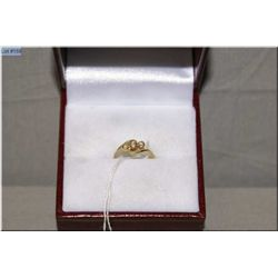 A 14kt yellow gold and diamond baby's ring