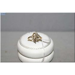 Lady's 10kt yellow gold and diamond ring set with 10X 0.1ct of brilliant white diamonds