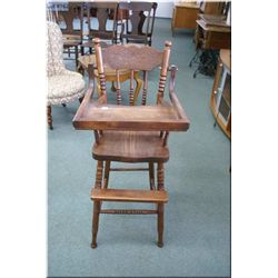 Vintage child's wooden highchair with pressed back