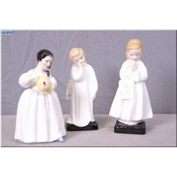 "Three small Royal Doulton figurines including ""Bedtime"" HN1978. ""Darling"" HN 1985 and ""Mandy"" HN2476"