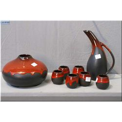 Selection of Beauce pottery including carafe with six cups and a vase