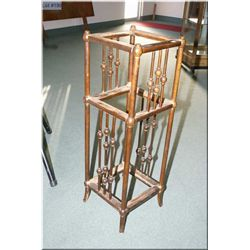 A three tier plant stand with turned spindle decoration