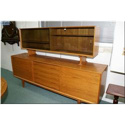 A Danish made teak sideboard with glass display sliding door, five drawer and two wooden sliding doo
