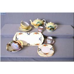 A selection of Oriental china including Nippon style teapot, cups, saucers and lidded sugar, hand pa