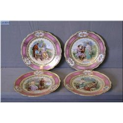 Four antique Austrian love scene wall plates with hand enamelling