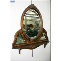 A large wood framed wall mount triple mirror and shelf etched center oval shaped mirror, and two sma