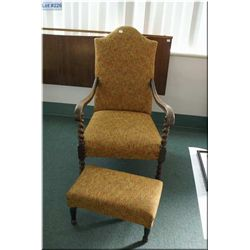A vintage upholstered armchair with barley twist supports and matching ottoman