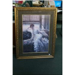 A large gilt framed print of a young lady in recline