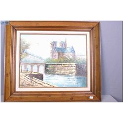 A framed original oil on canvas painting depicting a Paris canal scene signed by artist T. Carson 15