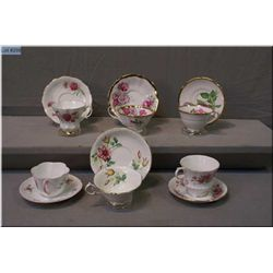 A selection of collectible cups and saucers including Royal Albert, Shelley, Paragon and Queen Anne
