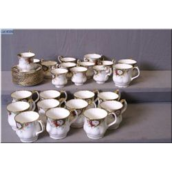 """Royal Albert """"Celebrations"""" cups and saucers including ten demitasses and fourteen coffee cups. Matc"""
