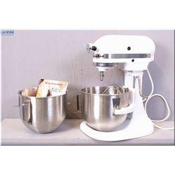 A vintage white Kitchenaid 260 Watt Mixer Model K555 with two bowls, three mixing heads and recipe b