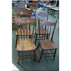 Four vintage wooden pressed back dining chairs