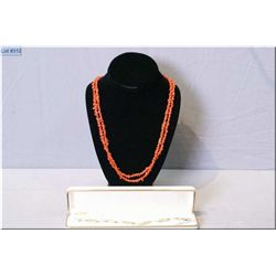 A vintage coral necklace strung with a gold clasp and a gold filled bracelet with genuine cultured p
