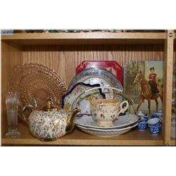 A selection of collectibles including tins, teapot, four demi-tasse cups and saucers, glass serving
