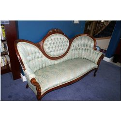Victorian style cameo back full sized sofa with carved floral decoration and button tufted upholster