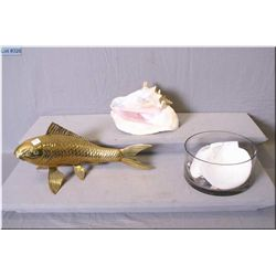 A selection of sea shells and a large brass fish
