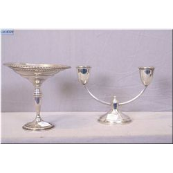A sterling silver stemmed dish with weighted base and a sterling silver candle holder with weighted