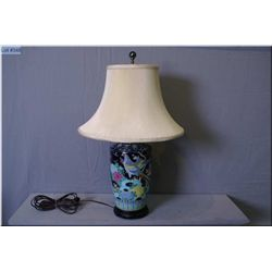 A hand enamelled bird motif porcelain table lamp