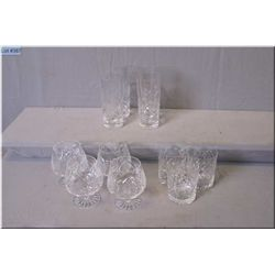 Twenty one pieces of quality crystal stemware with etched floral pattern including tumblers, water g