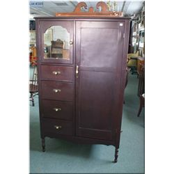 A vintage four drawer, two door wardrobe with mirror