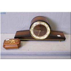 """A wood cased """"Forestville"""" mantle clock, working at time of cataloguing and a small wooden jewel box"""