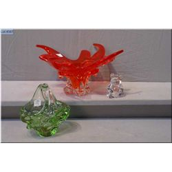 Selection of art glass including red bowl, green handled basket and crystal bear paper weight