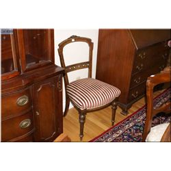 Antique Canadiana side chair with delicate carved decoration and reeded supports