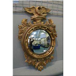 A framed eagle and acorn motif convex mirror