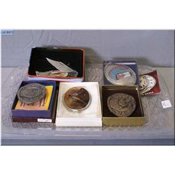Four men's belt buckles including Montana Centennial buckles, pheasant buckle and an American eagle