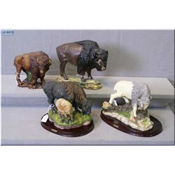 "Two ""Canadian Wilderness"" buffalo figures on wooden bases, a chalk ware buffalo and a wax buffalo fi"