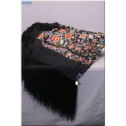 A large embroidered and fringed piano shawl