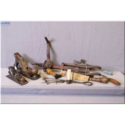 A selection of vintage tools including Stanley and Shelton wood planes, small hatchet, unique iron l