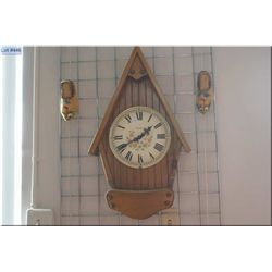 A Dutch style quartz wall clock and two Dutch shoes with matching shoe brushes