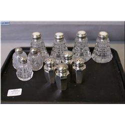 A selection of salt and peppers including Birks sterling plus a selection of crystal salt and pepper