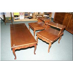 A mahogany coffee table and matching side tables with lamp stands.