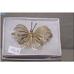 A sterling silver and filigree butterfly brooch