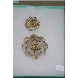 Two sterling silver filigree floral designed brooches