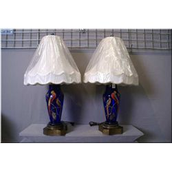 """A pair of cobalt glass hand enamelled bird motif lamps on metal bases, 14"""" to top of glass"""
