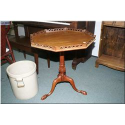 Antique mahogany center pedestal occasional table with pierced work galley and hand carved ball and
