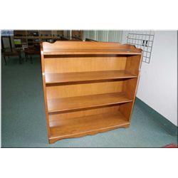 A maple bookshelf with 4 shelves.