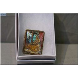 An antique sterling silver and hand painted brooch with quartz cover