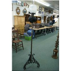 Unusual brass and cast floor standing oil lamp with glass hurricane and etched shade. Note: twists t